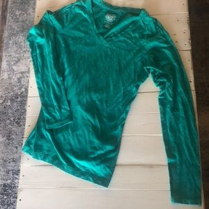 Long sleeved turquoise top